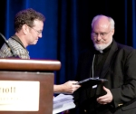 Fr. Patrick Bergquist accepts Voice of the Faithful Priest of Integrity Award